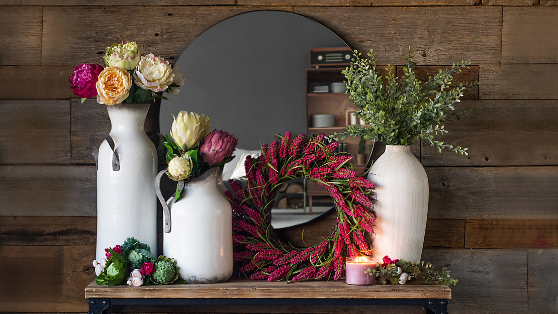 Spring floral on a shelf with a circular mirror